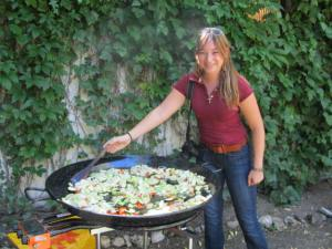 One kind chef let us help. Megan is giving the giant paella a good stir.