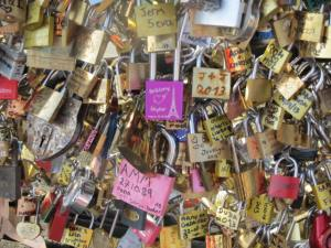 Walking across the Seine, we stopped to admire generations worth of love locks.